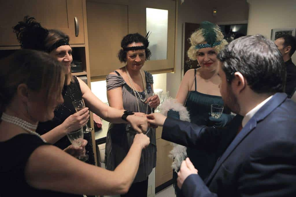 A magician entertains guests at a private party.